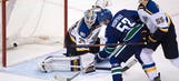 Henrik Sedin scores in OT, Canucks beat Blues 2-1