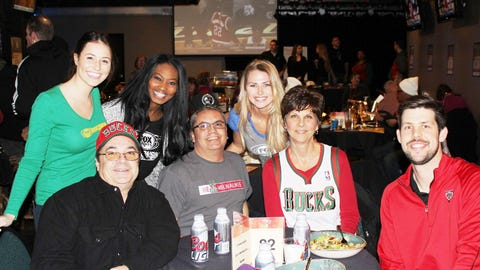 These Bucks fans are all smiles as their team notches a 115-100 win over the Orlando Magic.