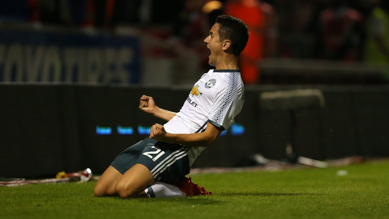 Manchester United beat Northampton to set up Man City clash