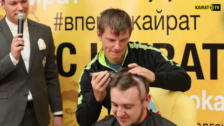 Watch Andrey Arshavin shave a blogger's head after winning a bet