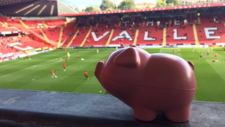 Charlton & Coventry fans throw toy pigs on the pitch to protest ownership groups