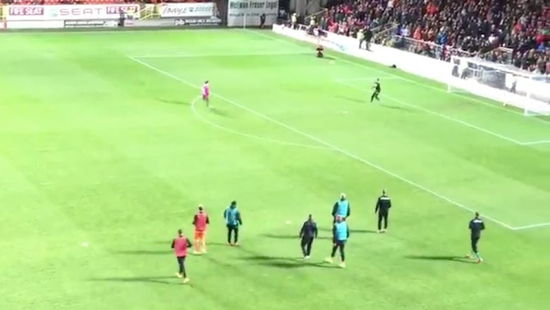 Watch this one-legged Dundee United fan score a Cantona-esque chip
