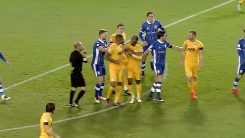 Watch two teammates get red cards for fighting ... each other