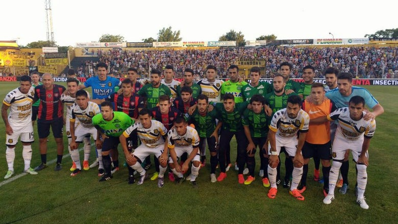San Lorenzo players wear kits they swapped with Chapecoense players in Copa semis
