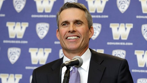 Chris Petersen smiles as he takes questions after being introduced as the new head football coach at the University of Washington, Monday, Dec. 9, 2013, in Seattle. Petersen formerly was head coach at Boise State. (AP Photo/Ted S. Warren)