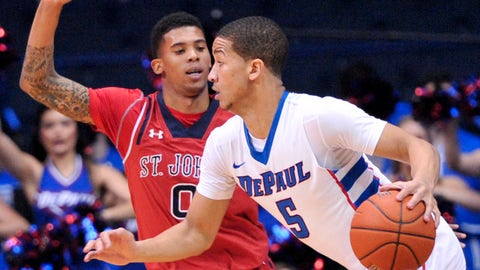 Jan 14, 2014; Rosemont, IL, USA; DePaul Blue Demons guard Billy Garrett Jr. (5) is defended by St. John's Red Storm guard Jamal Branch (0) during the first half at the Allstate Arena. Mandatory Credit: Rob Grabowski-USA TODAY Sports