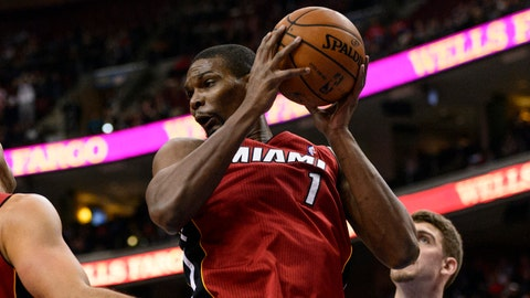 Jan 17, 2014; Philadelphia, PA, USA; Miami Heat center Chris Bosh (1) pulls down a rebound during the first quarter against the Philadelphia 76ers at the Wells Fargo Center. Mandatory Credit: Howard Smith-USA TODAY Sports