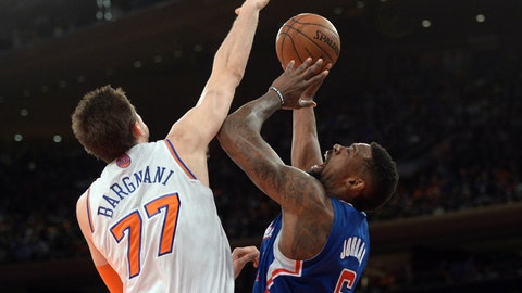 Jan 17, 2014; New York, NY, USA; Los Angeles Clippers center DeAndre Jordan (6) puts up a shot over New York Knicks power forward Andrea Bargnani (77) during the first half at Madison Square Garden. Mandatory Credit: Joe Camporeale-USA TODAY Sports
