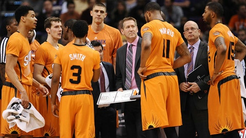 Jan 17, 2014; Phoenix, AZ, USA; Phoenix Suns head coach Jeff Hornacek talks with his team during a timeout against the Dallas Mavericks in the second half at US Airways Center. The Mavericks won 110-107. Mandatory Credit: Jennifer Stewart-USA TODAY Sports