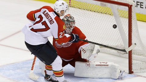 Florida Panthers center Nick Bjugstad (27) shoots the puck past Detroit Red Wings goalie Jonas Gustavsson (50) of Sweden for a goal during the shootout period of an NHL hockey game in Detroit, Sunday, Jan. 26, 2014. (AP Photo/Carlos Osorio)