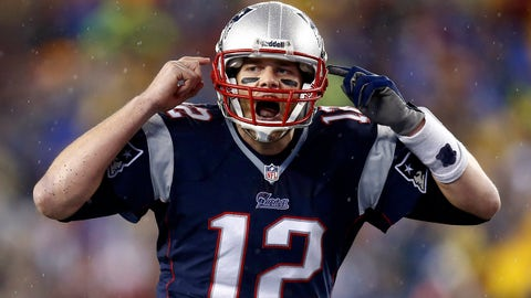 Jan 11, 2014; Foxborough, MA, USA; New England Patriots quarterback Tom Brady (12) gestures at the line in the second half during the 2013 AFC divisional playoff football game against the Indianapolis Colts at Gillette Stadium. Mandatory Credit: Mark L. Baer-USA TODAY Sports
