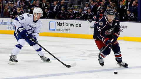 Jan 13, 2014; Columbus, OH, USA; Columbus Blue Jackets center Mark Letestu (55) controls the puck as Tampa Bay Lightning left wing Ondrej Palat (18) trails the play during the first period at Nationwide Arena. Mandatory Credit: Russell LaBounty-USA TODAY Sports