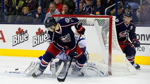 Jan 13, 2014; Columbus, OH, USA; Columbus Blue Jackets right wing Cam Atkinson (13) watches Tampa Bay Lightning goalie Anders Lindback (39) make the save on his tip shot during the third period at Nationwide Arena. Columbus beat Tampa Bay 3-2. Mandatory Credit: Russell LaBounty-USA TODAY Sports
