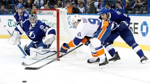 Jan 16, 2014; Tampa, FL, USA; Tampa Bay Lightning defenseman Eric Brewer (2) defends New York Islanders center John Tavares (91) during the first period at Tampa Bay Times Forum. Mandatory Credit: Kim Klement-USA TODAY Sports