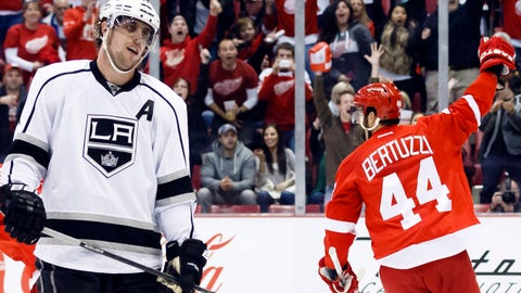 Jan 18, 2014; Detroit, MI, USA; Detroit Red Wings right wing Todd Bertuzzi (44) celebrates a goal by defenseman Niklas Kronwall (not pictured) as Los Angeles Kings center Anze Kopitar (11) reacts in the third period at Joe Louis Arena. Detroit won 3-2 in a shoot-out. Mandatory Credit: Rick Osentoski-USA TODAY Sports