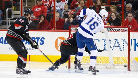 Jan 19, 2014; Raleigh, NC, USA; Tampa Bay Lightning forward Teddy Purcell (16) scores a goal against Carolina Hurricanes goalie Anton Khudobin (31) in the second period at PNC Arena. Mandatory Credit: James Guillory-USA TODAY Sports