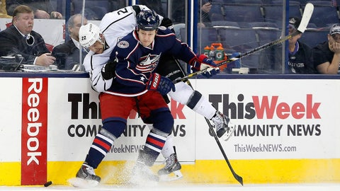 Jan 21, 2014; Columbus, OH, USA; Columbus Blue Jackets defenseman Nikita Nikitin (6) checks Los Angeles Kings center Trevor Lewis (22) during the second period at Nationwide Arena. Mandatory Credit: Russell LaBounty-USA TODAY Sports