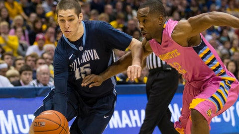 Jan 25, 2014; Milwaukee, WI, USA; Villanova Wildcats guard Ryan Arcidiacono (15) drives for the basket as Marquette Golden Eagles guard Derrick Wilson (12) defends during the second half at BMO Harris Bradley Center.  Villanova won 94-85.  Mandatory Credit: Jeff Hanisch-USA TODAY Sports