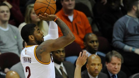 Jan 28, 2014; Cleveland, OH, USA; Cleveland Cavaliers point guard Kyrie Irving (2) shoots against New Orleans Pelicans point guard Brian Roberts (22) in the first quarter at Quicken Loans Arena. Mandatory Credit: David Richard-USA TODAY Sports
