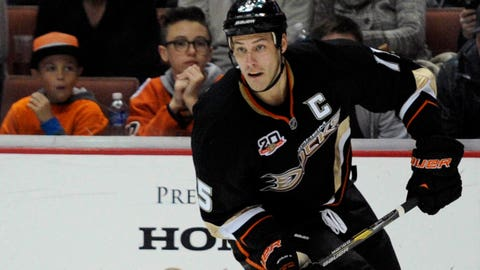 Jan 28, 2014; Anaheim, CA, USA; Anaheim Ducks center Ryan Getzlaf (15) moves the puck down the ice against the Minnesota Wild during the second period at the Honda Center. Mandatory Credit: Kelvin Kuo-USA TODAY Sports