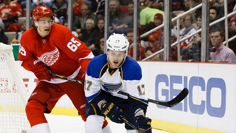 Jan 20, 2014; Detroit, MI, USA; St. Louis Blues center Vladimir Sobotka (17) skates with the puck defended by Detroit Red Wings defenseman Danny DeKeyser (65) in the second period at Joe Louis Arena. Mandatory Credit: Rick Osentoski-USA TODAY Sports