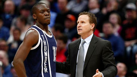 Jan 9, 2014; Denver, CO, USA; Oklahoma City Thunder head coach Scott Brooks talks with point guard Reggie Jackson (15) in the second quarter at the Pepsi Center. Mandatory Credit: Isaiah J. Downing-USA TODAY Sports