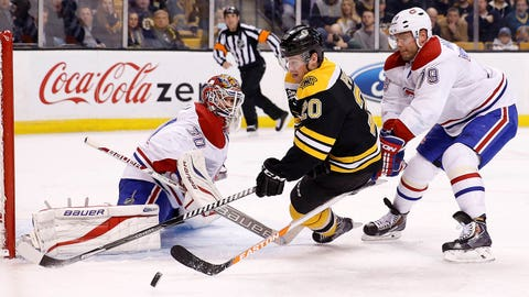 Jan 30, 2014; Boston, MA, USA;  Boston Bruins left wing Daniel Paille (20) shoots the puck against Montreal Canadiens goalie Peter Budaj (30) as defenseman Andrei Markov (79) chases during the third period at TD Banknorth Garden. The Montreal Canadiens won 4-1. Mandatory Credit: Greg M. Cooper-USA TODAY Sports