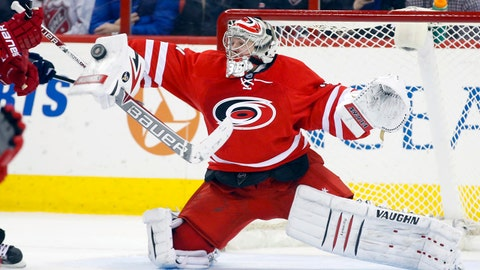 Jan 31, 2014; Raleigh, NC, USA; Carolina Hurricanes goalie Anton Khudobin (31) reaches out to make a save during the 2nd period against the St. Louis Blues at PNC Arena. The Carolina Hurricanes defeated the St. Louis Blues 3-1. Mandatory Credit: James Guillory-USA TODAY Sports