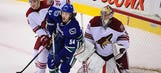 Coyotes dropped by Canucks in OT