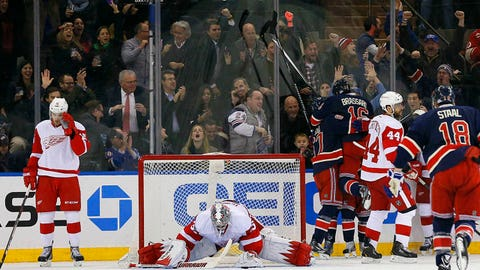 Jan 16, 2014; New York, NY, USA; The New York Rangers celebrate a goal scored by New York Rangers right wing Mats Zuccarello (36) against Detroit Red Wings goalie Jimmy Howard (35) during the third period at Madison Square Garden. The Rangers won 1-0. Mandatory Credit: Adam Hunger-USA TODAY Sports