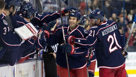 Jan 30, 2014; Columbus, OH, USA; Columbus Blue Jackets center Derek MacKenzie (24) is congratulated for his goal against the Washington Capitals at Nationwide Arena. Mandatory Credit: Greg Bartram-USA TODAY Sports
