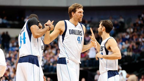 Jan 31, 2014; Dallas, TX, USA; Dallas Mavericks power forward Dirk Nowitzki (41) is congratulated by power forward Brandan Wright (34) and point guard Jose Calderon (right) after a score during the game against the Sacramento Kings at American Airlines Center. Mandatory Credit: Kevin Jairaj-USA TODAY Sports