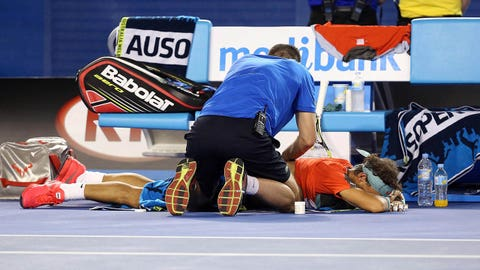 Jan 26, 2014; Melbourne, AUSTRALIA; Rafael Nadal (ESP) receives medical treatment during his match against Stanislas Wawrinka (SUI) in the men's singles championship match on day fourteen of the 2014 Australian Open at Melbourne Park.  Mandatory Credit: Nicolas Luttiau/Presse Sports via USA TODAY Sports