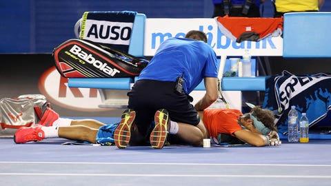 Jan 26, 2014; Melbourne, AUSTRALIA; Rafael Nadal (ESP) receives medical treatment during his match against Stanislas Wawrinka (SUI) in the men's singles championship match on day fourteen of the 2014 Australian Open at Melbourne Park.  Mandatory Credit: Nicolas Luttiau/Presse Sports via USA TODAY Sports