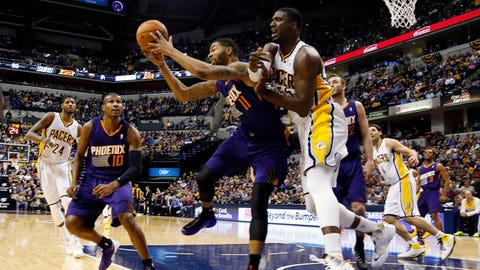Jan 30, 2014; Indianapolis, IN, USA; Indiana Pacers center Roy Hibbert (55) battles for a rebound against Phoenix Suns forward Markieff Morris (11) at Bankers Life Fieldhouse. Phoenix defeats Indiana 102-94. Mandatory Credit: Brian Spurlock-USA TODAY Sports
