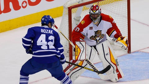 Jan 30, 2014; Toronto, Ontario, CAN; Toronto Maple Leafs forward Tyler Bozak (42) shoots the puck against  Florida Panthers goaltender Scott Clemmensen (30) at the Air Canada Centre. Toronto defeated Florida 6-3. Mandatory Credit: John E. Sokolowski-USA TODAY Sports