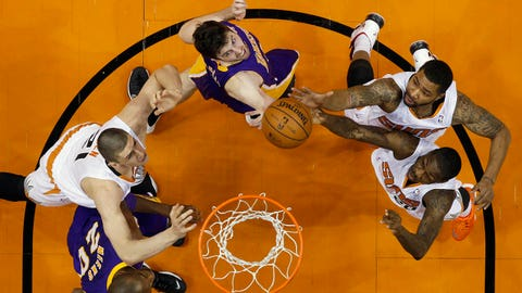 Phoenix Suns, from left, Alex Len, Markieff Morris and Archie Goodwin vie for a rebound with Los Angeles Lakers Jodie Meeks, lower left, and Ryan Kelly during an NBA basketball game Wednesday, Jan. 15, 2014, in Phoenix. (AP Photo/The Arizona Republic, Michael Chow) MESA OUT  MARICOPA COUNTY OUT  MAGS OUT