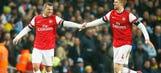 Podolski puts Arsenal ahead