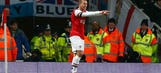 Podolski adds to Arsenal lead