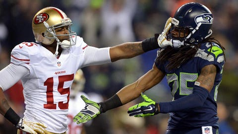 Jan 19, 2014; Seattle, WA, USA; Seattle Seahawks cornerback Richard Sherman (25) gets shoved in the face by San Francisco 49ers wide receiver Michael Crabtree (15) while trying to shake hands after an interception by Seahawks outside linebacker Malcolm Smith (not pictured) during the second half of the 2013 NFC Championship football game at CenturyLink Field. Mandatory Credit: Kirby Lee-USA TODAY Sports