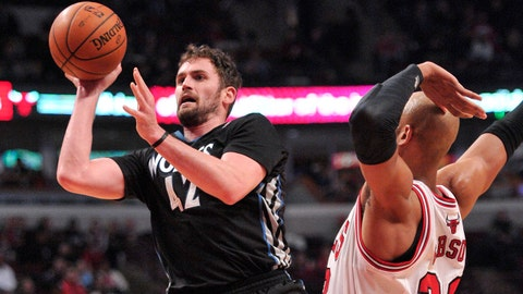 Jan 27, 2014; Chicago, IL, USA; Minnesota Timberwolves power forward Kevin Love (42) shoots the ball past Chicago Bulls power forward Taj Gibson (22) during the second half at the United Center. The Timberwolves beat the Bulls 95-86. Mandatory Credit: Rob Grabowski-USA TODAY Sports