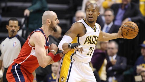 Jan 10, 2014; Indianapolis, IN, USA; Indiana Pacers forward David West (21) is guarded by Washington Wizards center Marcin Gortat (4) at Bankers Life Fieldhouse. Mandatory Credit: Brian Spurlock-USA TODAY Sports