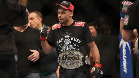 Feb 1, 2014; Newark, NJ, USA; Renan Barao (red gloves) celebrates after beating Urijah Faber (not pictured) during UFC 169 at Prudential Center. Mandatory Credit: Joe Camporeale-USA TODAY Sports