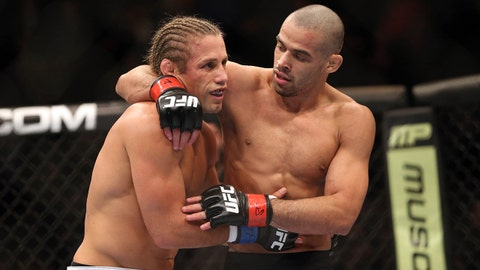 Feb 1, 2014; Newark, NJ, USA; Renan Barao (red gloves) and Urijah Faber (blue gloves) after their fight during UFC 169 at Prudential Center. Mandatory Credit: Joe Camporeale-USA TODAY Sports