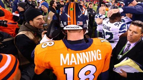 Feb 2, 2014; East Rutherford, NJ, USA; Denver Broncos quarterback Peyton Manning (18) leaves the field after Super Bowl XLVIII against the Seattle Seahawks at MetLife Stadium.  Mandatory Credit: Mark J. Rebilas-USA TODAY Sports