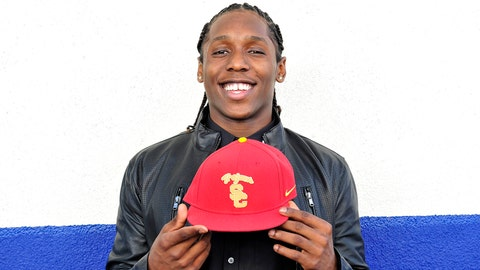 Feb 5, 2014; Gardena, CA, USA; Junipero Serra high school cornerback Adoree Jackson poses for a photo after signs with the University of Southern California during national signing day at Junipero Serra High School. Mandatory Credit: Gary A. Vasquez-USA TODAY Sports