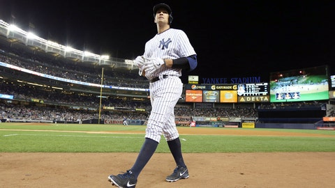 Sep 24, 2013; Bronx, NY, USA; New York Yankees third baseman Alex Rodriguez walks back to the dugout after flying out to end the fourth inning against the Tampa Bay Rays at Yankee Stadium. Mandatory Credit: John Munson/THE STAR-LEDGER via USA TODAY Sports