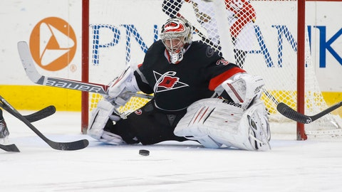 Feb 7, 2014; Raleigh, NC, USA; Carolina Hurricanes goalie Anton Khudobin (31) makes a save during the second period against the Florida Panthers at PNC Arena. The Hurricanes won  5-1. Mandatory Credit: James Guillory-USA TODAY Sports