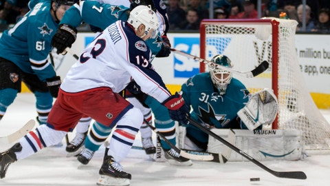 Feb 7, 2014; San Jose, CA, USA; Columbus Blue Jackets right wing Cam Atkinson (13) attempts to shoot the puck against San Jose Sharks defenseman Brad Stuart (7) and goalie Antti Niemi (31) during the first period at SAP Center at San Jose. Mandatory Credit: Ed Szczepanski-USA TODAY Sports