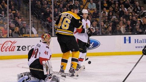 Feb 8, 2014; Boston, MA, USA; Ottawa Senators goalie Craig Anderson (41) makes a save in front of Boston Bruins center David Krejci (46) during the third period at TD Banknorth Garden. Mandatory Credit: Bob DeChiara-USA TODAY Sports